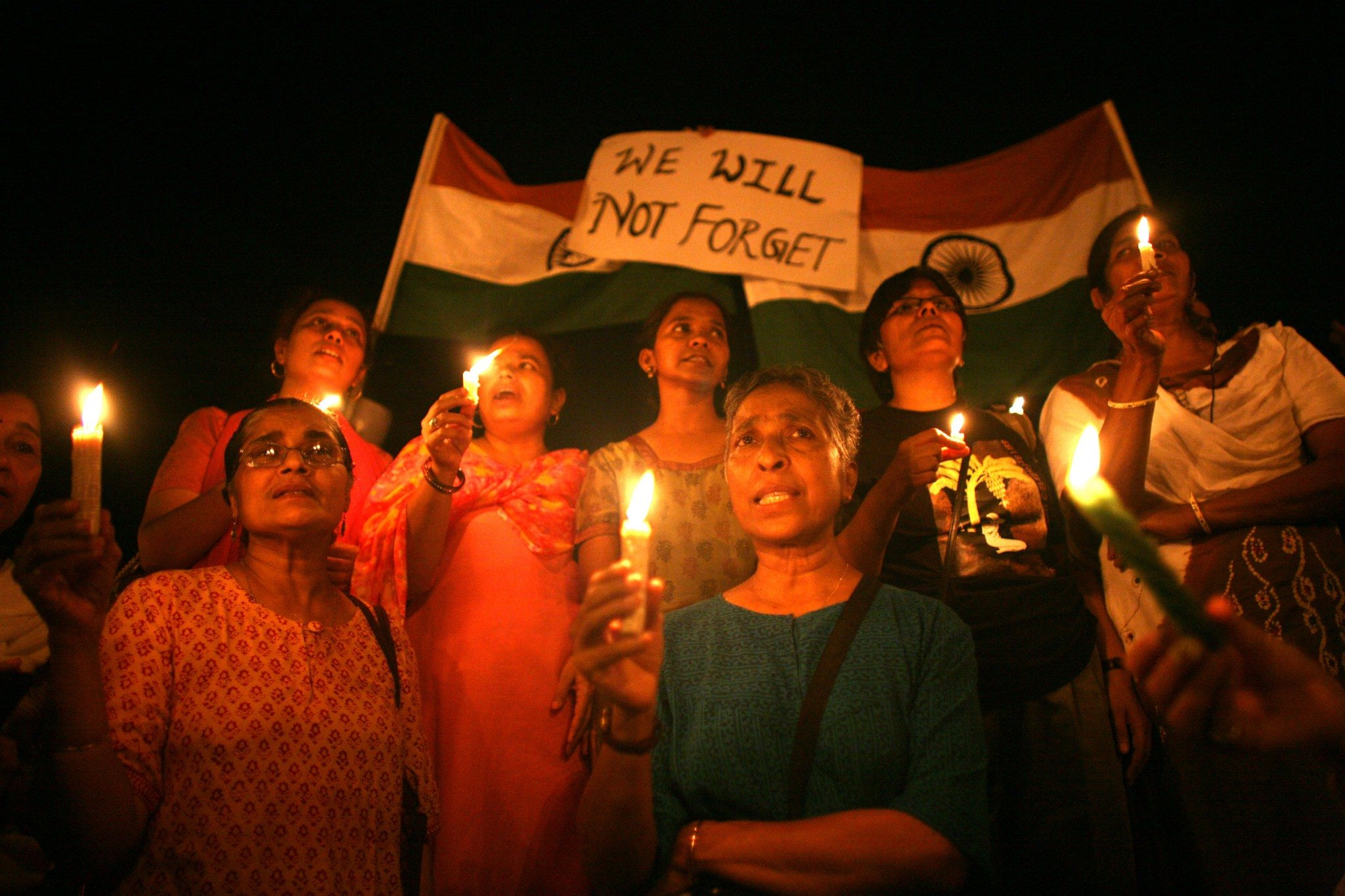 "MUMBAI (BOMBAY), INDIA - NOVEMBER 30: (ISRAEL OUT) Mumbai Residents attend a candlelit vigil in the street near The Oberoi Hotel following a demonstration against the recent terror attacks in the city on November 30, 2008 in Mumbai, India. Indian Home Minister Shivraj Patil today submitted his resignation claiming ""moral responsibility"" following the Mumbai terror attacks. The city of Mumbai was rocked by multiple coordinated terrorist attacks that targeted locations popular with foreigners, late on November 26, killing nearly 200 people. (Photo by Uriel SinaiGetty Images)"