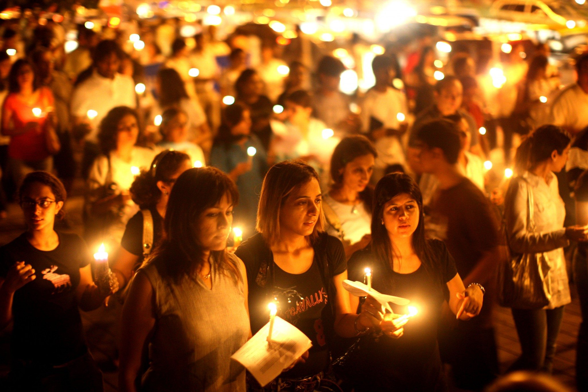 MUMBAI (BOMBAY), INDIA - NOVEMBER 30: (ISRAEL OUT) Mumbai Residents walk with candles in the street near The Oberoi Hotel during a demonstration against the recent terror attacks in the city on November 30, 2008 in Mumbai, India. Indian Home Minister Shivraj Patil today submitted his resignation claiming 'moral responsibility' following the Mumbai terror attacks. Following the multiple coordinated terrorist attacks that began on November 26 and targeted a railway station, two hotels, a hospital and cafe as well as the Jewish centre, around 174 people have died, including at least 22 foreigners, and around 295 people injured. Two NSG commandos lost their lives and eight were injured during the counter-terrorist operations. (Photo by Uriel Sinai/Getty Images)