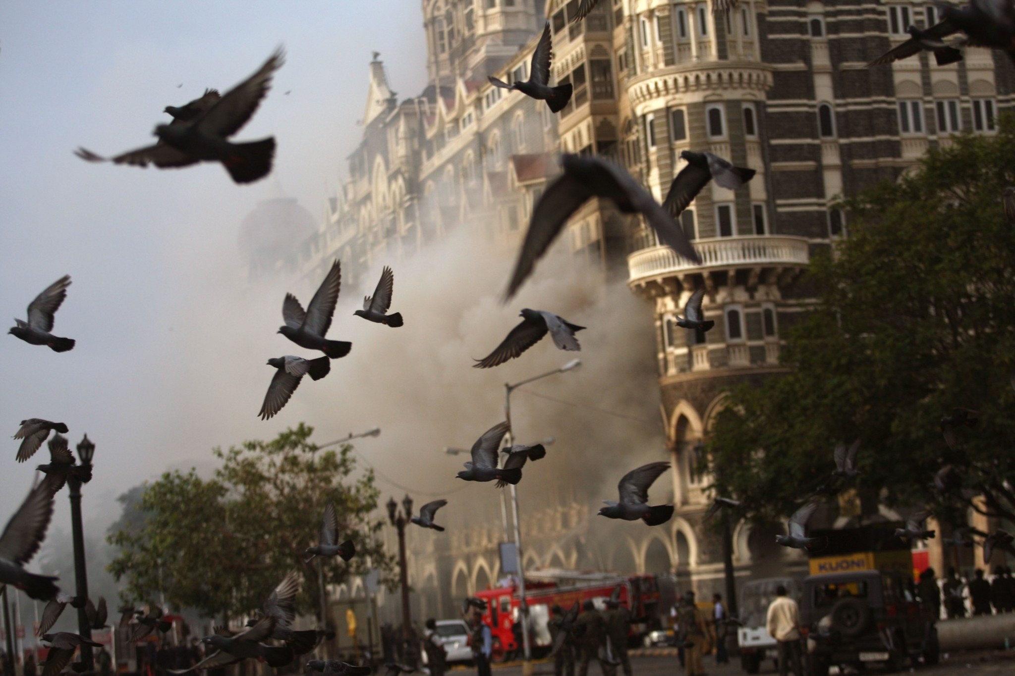 MUMBAI (BOMBAY), INDIA - NOVEMBER 29: (ISRAEL OUT) Birds fly over a fire as it burns at Taj Mahal Palace & Tower Hotel following an armed siege on November 29, 2008 in Mumbai, India. Indian officials have declared the siege at the Taj hotel over as the remaining militants were killed when commandos stormed the building. The city of Mumbai was rocked by multiple coordinated terrorist attacks that targeted locations popular with foreigners, late on November 26, killing at least 195 people. (Photo by Uriel Sinai/Getty Images)
