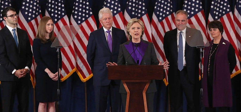 NEW YORK, NY - NOVEMBER 09: Former Secretary of State Hillary Clinton concedes the presidential election as (L-R) Marc Mezvinsky, Chelsea Clinton, Bill Clinton, Tim Kaine and Anne Holton listen at the New Yorker Hotel on November 9, 2016 in New York City. Republican candidate Donald Trump won the 2016 presidential election in the early hours of the morning in a widely unforeseen upset. (Photo by Justin Sullivan/Getty Images)