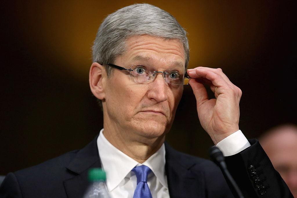 WASHINGTON, DC - MAY 21:  Apple CEO Timothy Cook testifies before the Senate Homeland Security and Governmental Affairs Committee's Investigations Subcommittee about the company's offshore profit shifting and tax avoidance in the Dirksen Senate Office Building on Capitol Hill May 21, 2013 in Washington, DC. A Congressional report released yesterday said that Apple, America's most profitable technology company, used a complex system of international subsidiaries and tax avoidance efforts to shift at least $74 billion out of the reach of the Internal Revenue Service between 2009 and 2012.  (Photo by Chip Somodevilla/Getty Images)