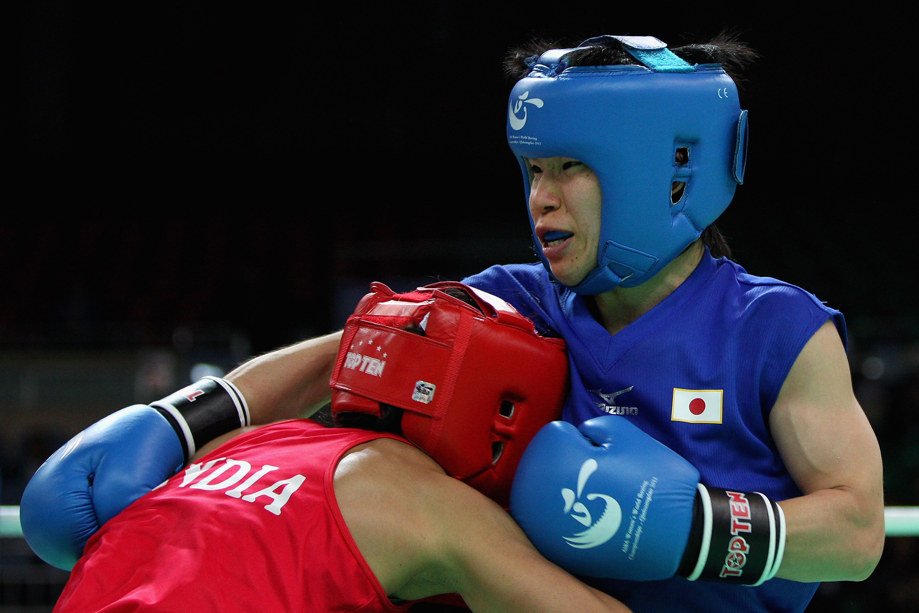 QINHUANGDAO, CHINA - MAY 13: Ayako Minowa (Red) of Japan fights against Mery Kom Hmangte (Blue) of India in the Women's 51kg preliminary match during the AIBA Women's World Boxing Championships on May 13, 2012 in Qinhuangdao, China. The AIBA Women's World Boxing Championships 2012 which is a London Olympic Games Qualifying Event will be held from May 11 to 19. (Photo by Feng Li/Getty Images)