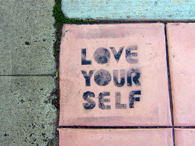 "A tile saying ""love your self""."