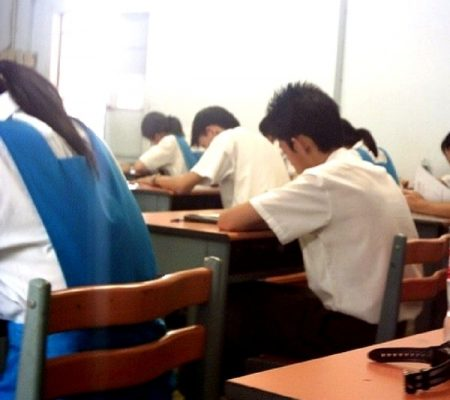 students writing their exams.
