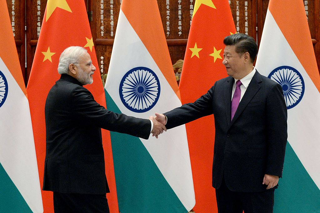 SEPTEMBER 4: Indian Prime Minister Narendra Modi (L) shakes hands with Chinese President Xi Jinping (R) at the West Lake State Guest House on September 4, 2016 in Hangzhou, China. The 11th G20 Leaders Summit will be held from September 4-5.