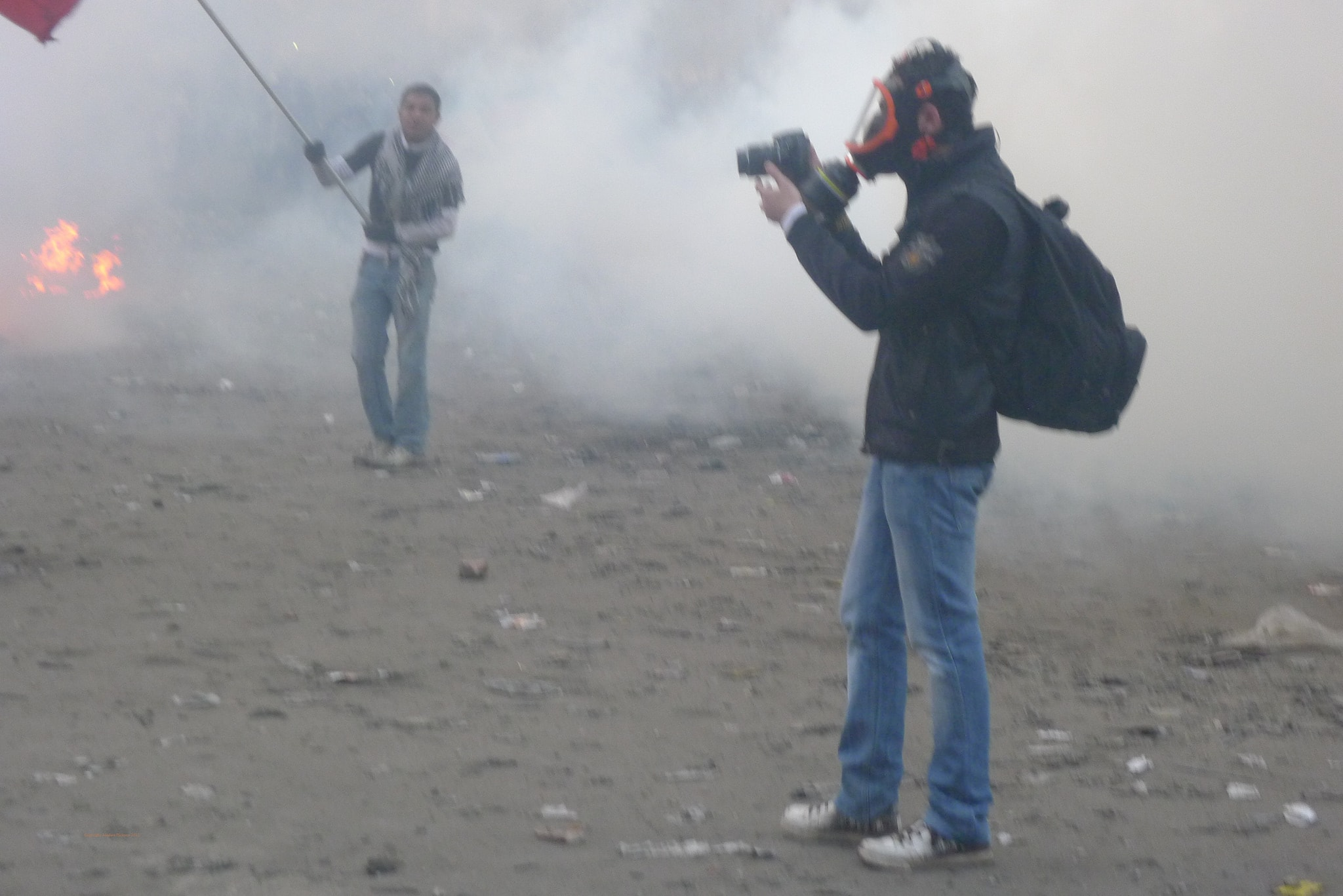 Journalist wearing a gas mask during protests in Cairo