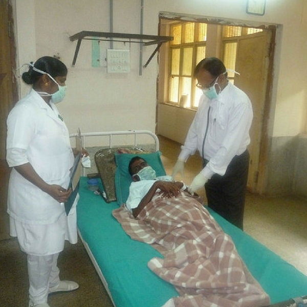 Chest physician Dr Prabhu and staff nurse Mala examine and evaluate a patient who defaulted on his anti-tuberculosis treatment (ATT) and is now a MDR (multi-drug resistant) TB suspect.