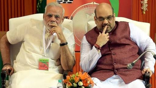 Narendra Modi, Prime Minister from 2014-2019, and Amit Shah BJP President, in deep thought.