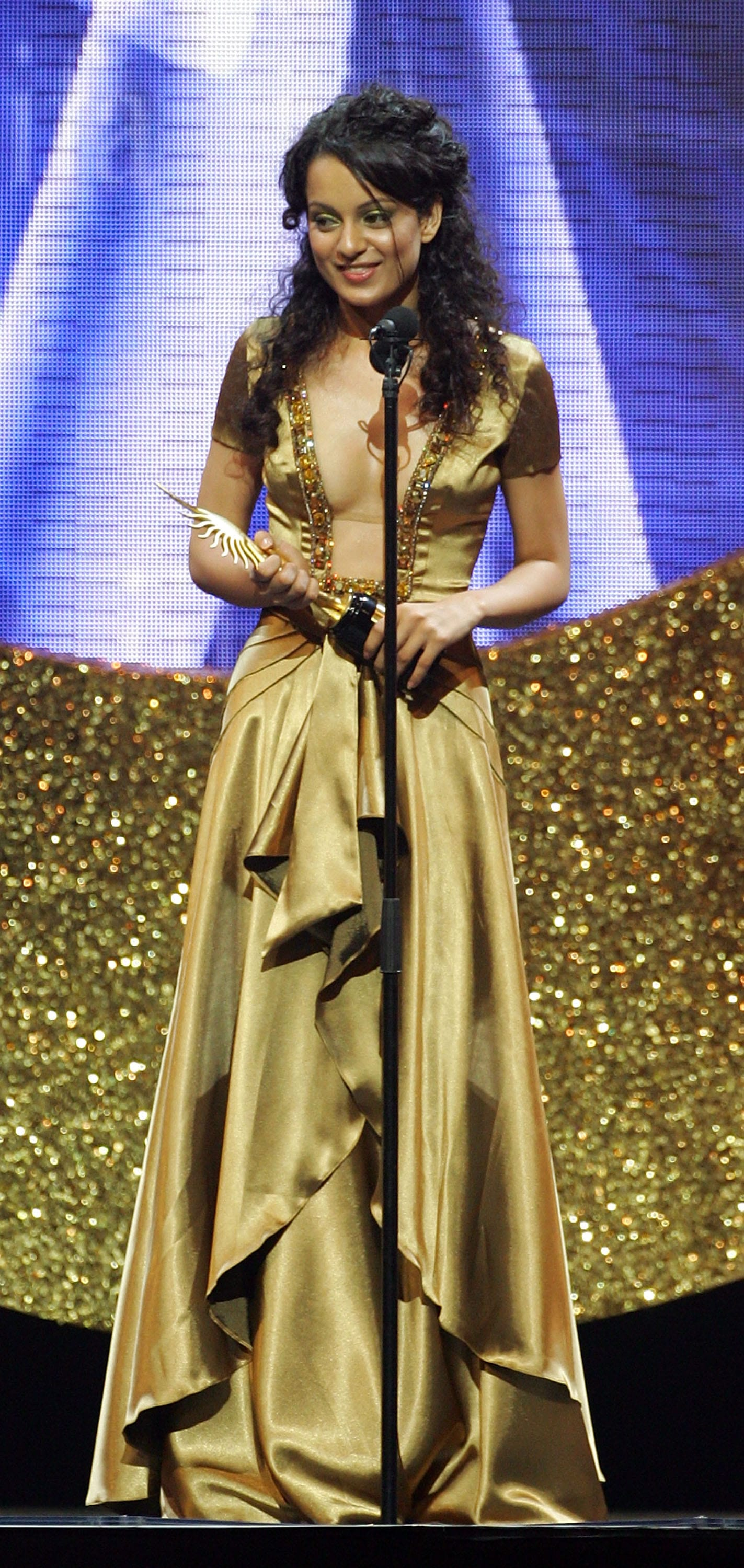 Bollywood actress Kangana Ranaut collects an award on stage at the International Indian Film Academy Awards (IIFAs).