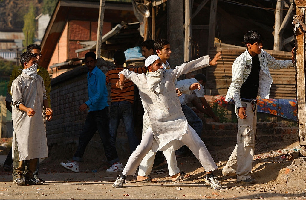 Kashmiri rock throwing protesters attack Indian paramilitary as tensions on the streets erupt