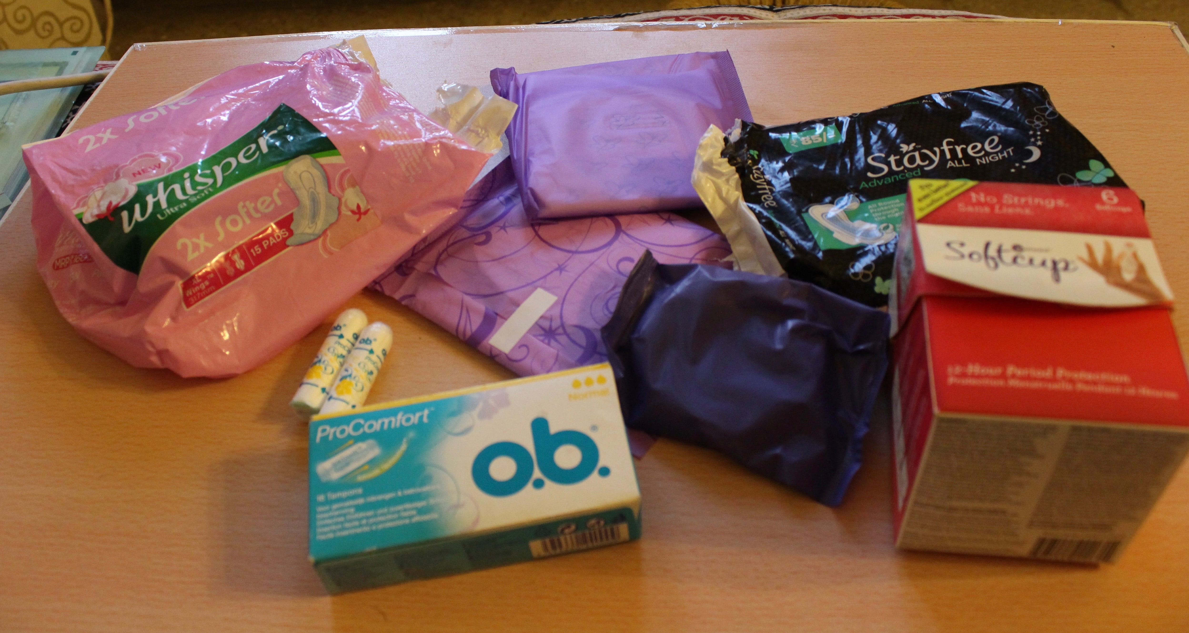 A picture of sanitary pads, tampons and menstrual cups.