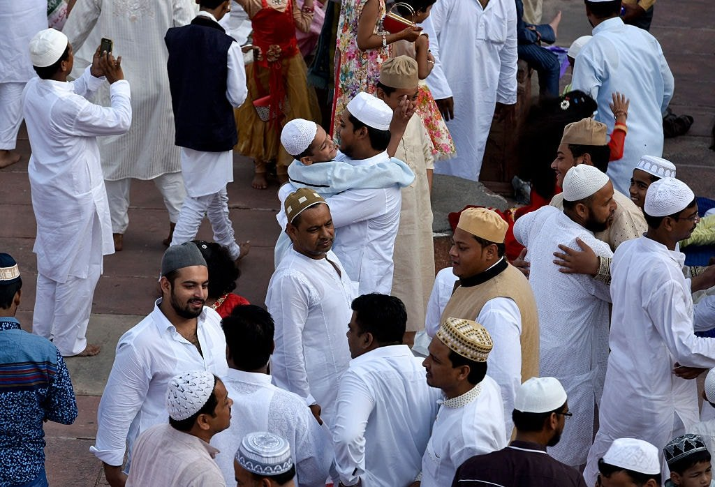 Muslims hug each other during Bakr-Id celebrations