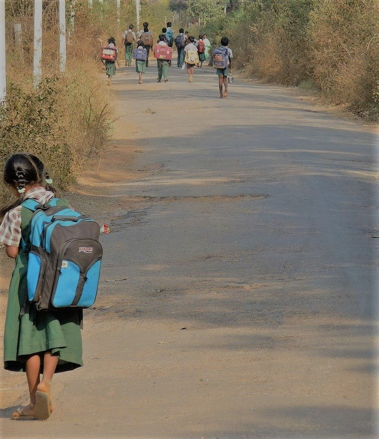 children going to school in a rural/semi urban area