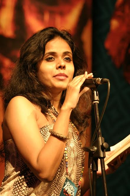 Activist Meena Kandasamy speaking at an event