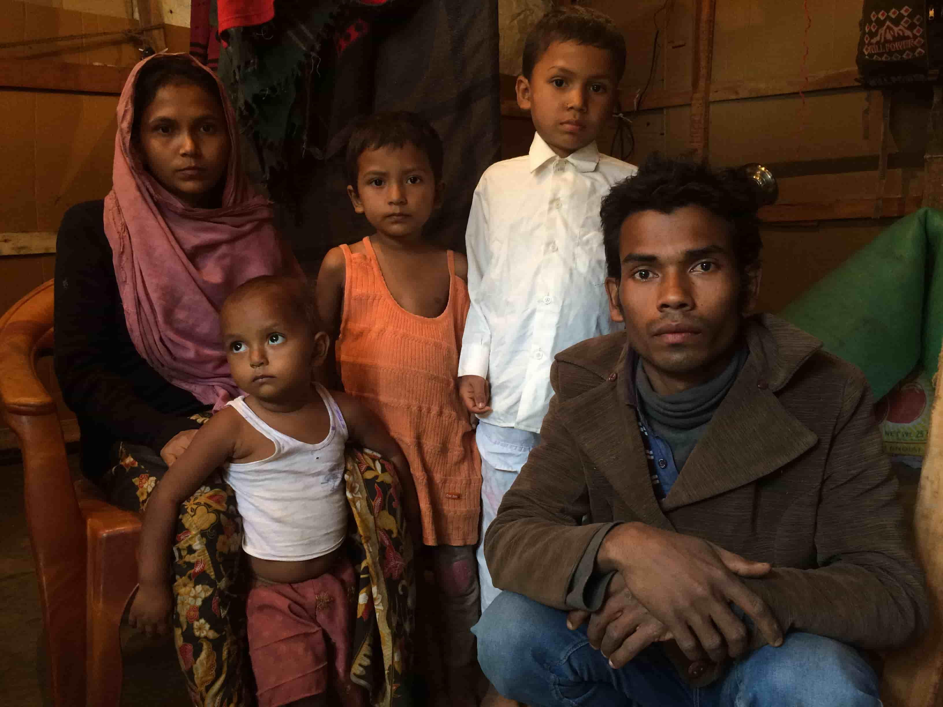 Khalija Bibi, a Rohingya Muslim refugee with her family in a juggi in Jammu.