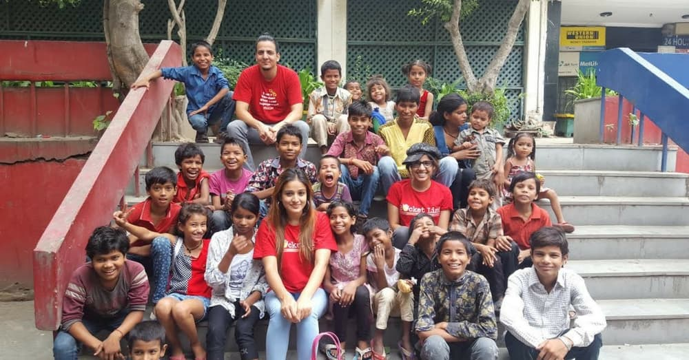 Rida Ali with children from the streets