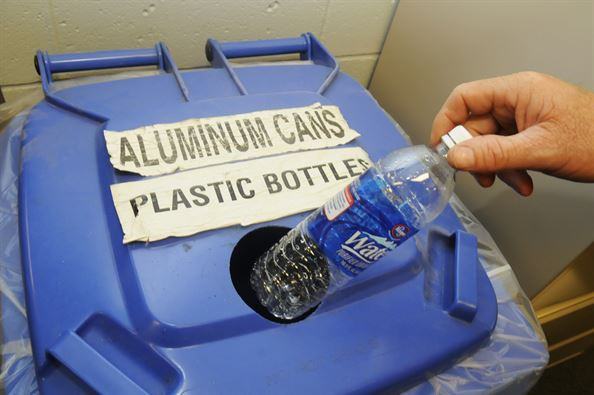 Plastic bottle being segregated as recyclable waste
