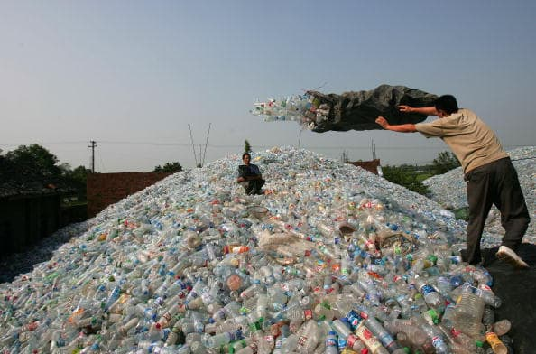 Workers Sort Out Plastic Bottles At Chinese Disposal Site