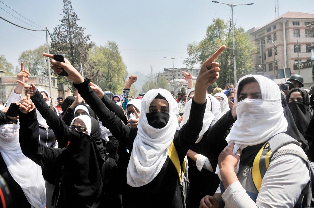 Kashmiri students shout slogans during a protest in Srinagar
