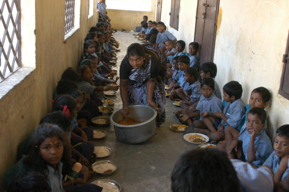 Distributing Mid Day Meal to Primary School students