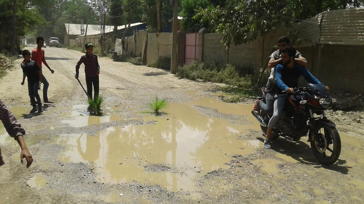 Pot-holed roads in Budgam