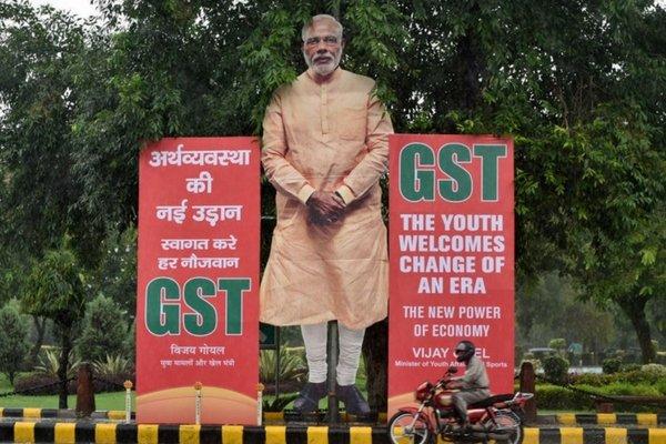 Narendra Modi's cutout, and the GST