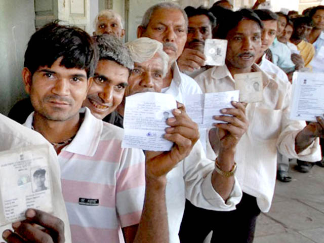 Workers holding their identity cards