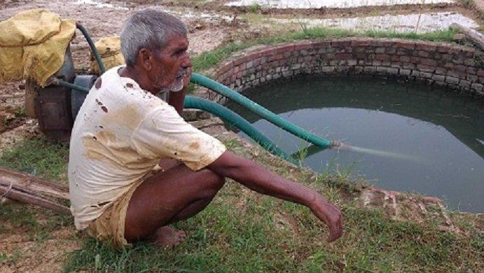 Jamui Farmer Janki Da in His Field near his well