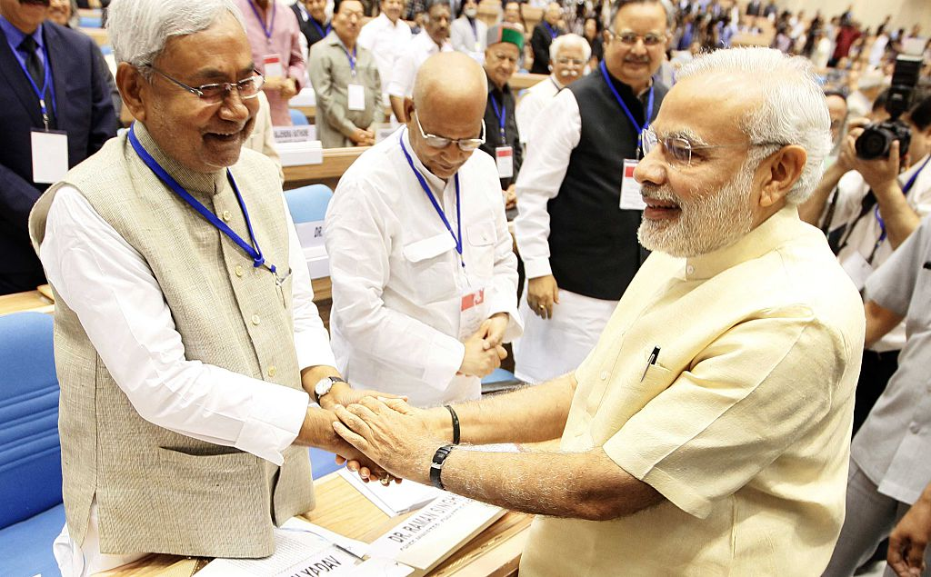Nitish Kumar shares a light-hearted handshake with Narendra Modi