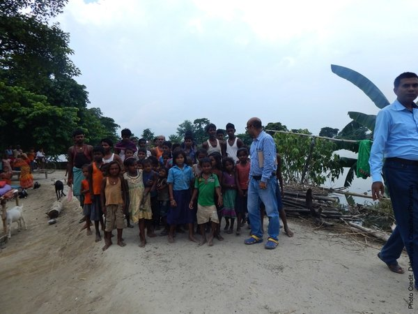 Plan India's staff members with children from the affected community.