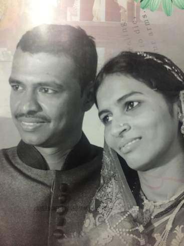 A black and white photograph of Aisha and Imran looking into the distance together.
