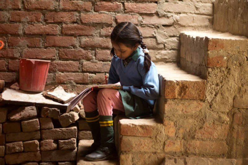 A girl studying at home.