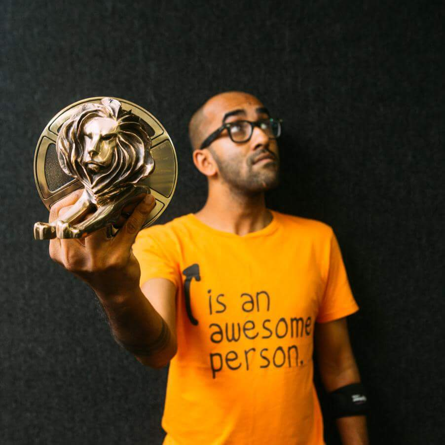 Anup J Kat, founder and chief optimist at 1st December Films, posing with the Cannes Lion they won for an ad film. Image: Facebook/Anup J Kat