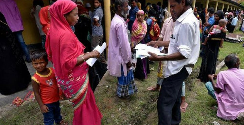 People waiting to register at an NRC centre in Assam