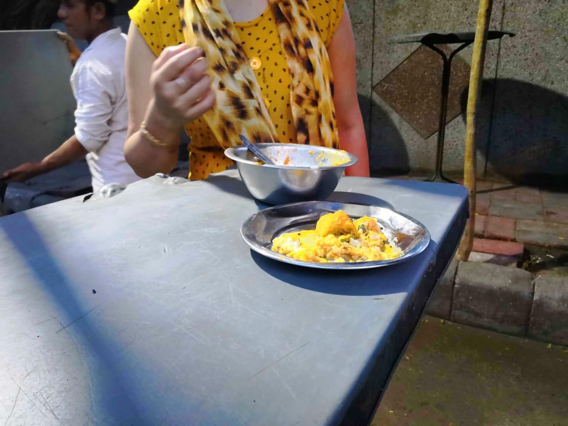 Customers enjoying food in steel utensils