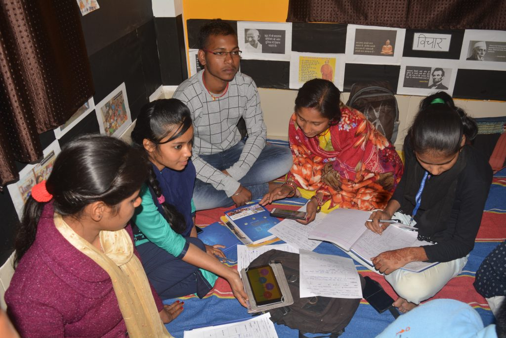 Taniya (second from left) leading an activity in her group during training