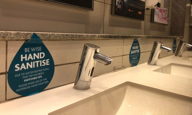 SIgn in airport washroom to avoid using taps.