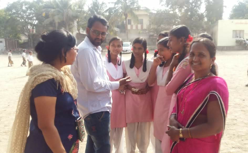 Girls discussing after P for Period session in a rural school