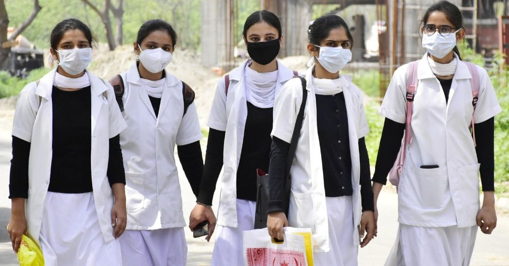Nursing students wearing protective face masks as precaution against coronavirus