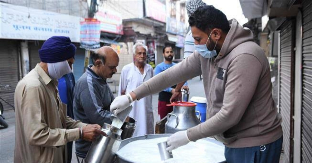 A person serving milk to people