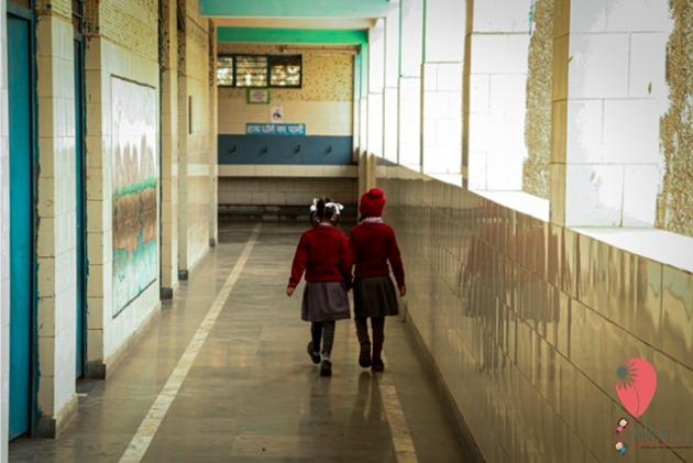 Two girls in a school corridor