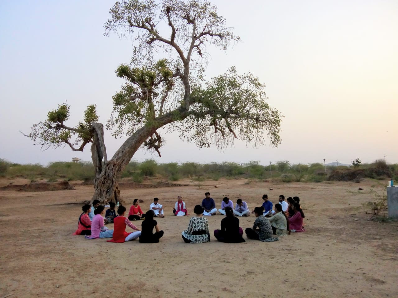 Young people sitting in a circle