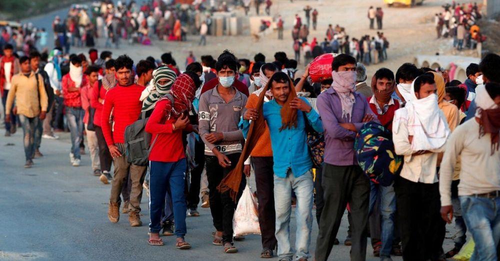 migrant labourers walking home