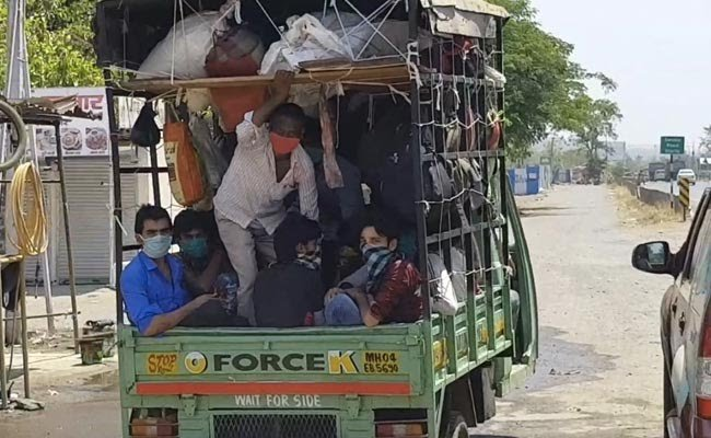 Migrants crammed in a van trying to get to their homes.