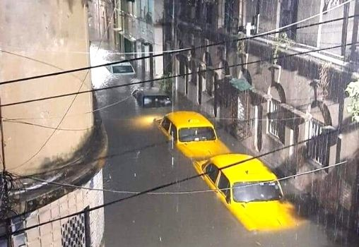 yellow taxis submerged on a road in Kolkata during Cyclone Amphan