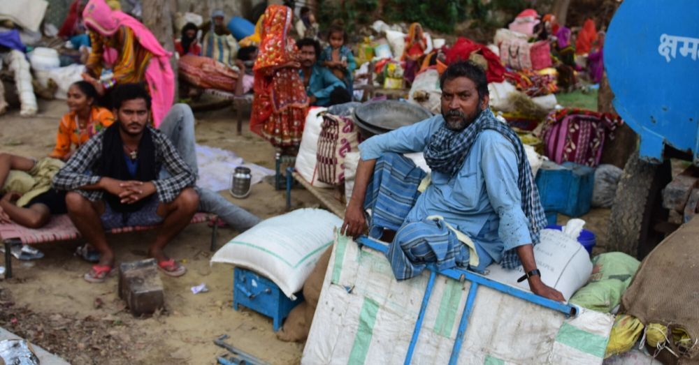 Migrant Labourers sitting