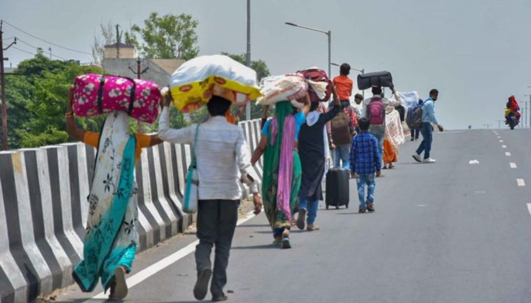MIGRANT WORKERS WALK HOME DUE TO NO PROPER TRANSPORTATION.