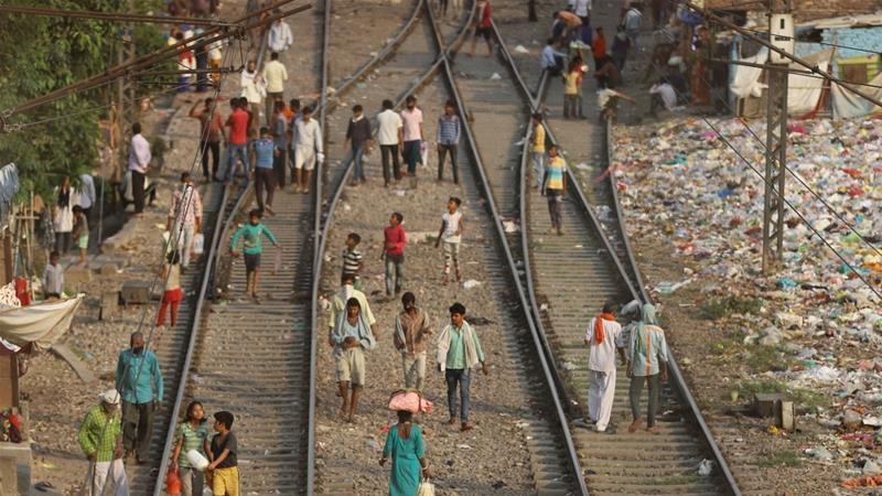 Migrants walking on railway tracks