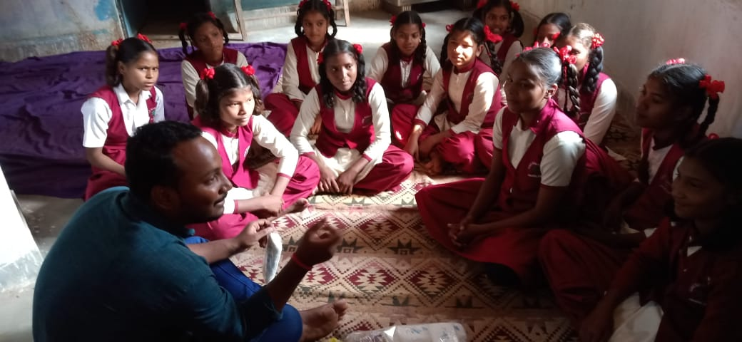 Ayush, through his initiative 'Mission Babunia', engaging students in discussions on menstruation health and hygiene.