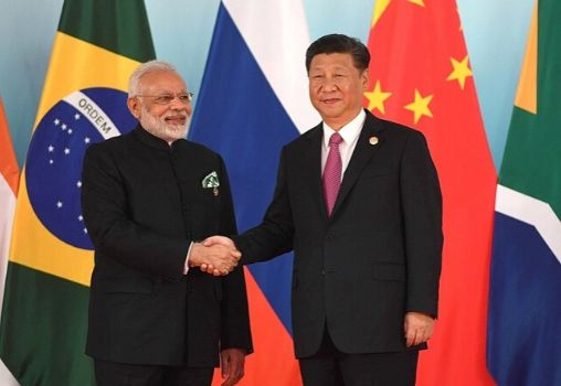 modi and xi jinping shaking hands at the BRICS meeting in 2017.
